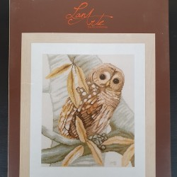 Owl and autumn leave